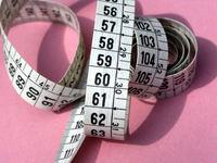 Met een meetlint kun je je taille omvang meten.